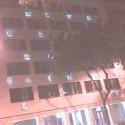 zahadna budova v BA: je na hlavnej pri palaci, v noci je vysvietena aj ked jej vnutro posobi rozostavane a opustene a jej priecielie zdobia rozne random pismena. vie niekto viac?