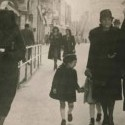 Muslim woman covers the yellow star of her Jewish neighbor with her veil on the streets of Sarajevo in 1941